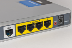 A typical home or small office router showing the                                 ADSL                                telephone line and                                 Ethernet                                network cable connections