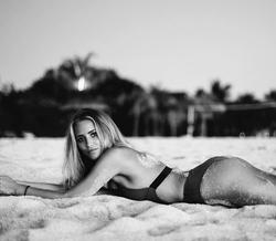 Janni posing in a bikini during a photoshoot