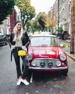 Photo of Janni in London next to a Mini
