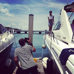 """A behind the scenes photo of a model's photo shoot taken """"on location"""" for a magazine editorial"""