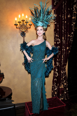 Podium model modeling a dress by Sue Wong