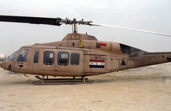 An                                 Iraqi Air Force                                                 Bell 214ST                                                 transport helicopter                                , after being captured by a US Marine Corps unit at the start of the ground phase of Operation Desert Storm.