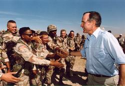 President Bush visiting American troops in Saudi Arabia on                                 Thanksgiving Day                                , 1990.