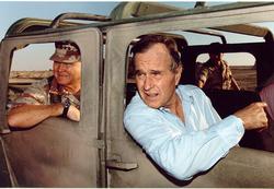 General                                 Norman Schwarzkopf, Jr.                                and President                                 George H. W. Bush                                visit U.S. troops in Saudi Arabia on                                 Thanksgiving Day                                , 1990.