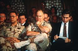 Gen.                                 Colin Powell                                (left), Gen.                                 Norman Schwarzkopf, Jr.                                , and                                 Paul Wolfowitz                                (right) listen as Secretary of Defense                                 Dick Cheney                                addresses reporters regarding the 1991 Gulf War.