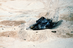 An Iraqi T-54A or Type 59 tank lies destroyed after a Coalition bombing attack during Operation Desert Storm.