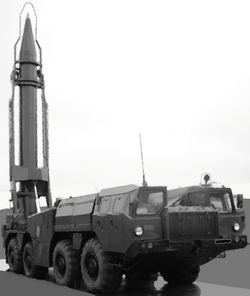 Scud                                Transporter Erector Launcher (TEL) with missile in upright position.