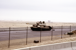 Iraqi Type 69 tank on the road into                                 Kuwait City                                during the Gulf War.