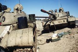 Two Iraqi tanks lie abandoned near Kuwait City on 26 February 1991.