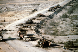 Aerial view of destroyed Iraqi                                 T-72                                tank,                                 BMP-1                                and                                 Type 63                                armored personnel carriers and trucks on Highway 8 in March 1991