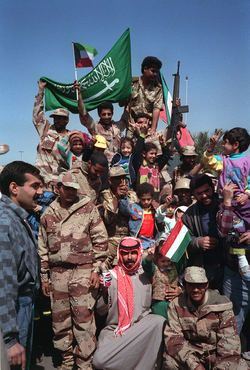 Civilians and Coalition military forces wave Kuwaiti and                                 Saudi Arabian                                flags as they celebrate the retreat of Iraqi forces from Kuwait as a result of Operation Desert Storm