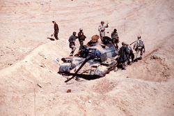French and American soldiers inspecting an Iraqi                                 Type 69                                tank destroyed by the French                                 6th Light Armored Division                                during Operation Desert Storm.