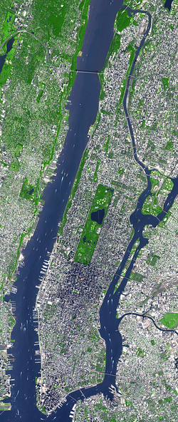 Central Park in the center of satellite image. Manhattan is bound by Hudson River to the west, Harlem River to the north, and East River.