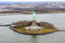 Liberty Island is an exclave of Manhattan, of New York City, and of New York State, surrounded by New Jersey waters.