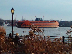 The Staten Island Ferry, seen from Battery Park crosses Upper New York Bay providing free public transportation between Staten Island and Manhattan.