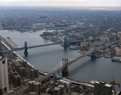 The Brooklyn Bridge in the foreground and the Manhattan Bridge beyond it, are two of the three bridges that connect Lower Manhattan with Brooklyn over the East River