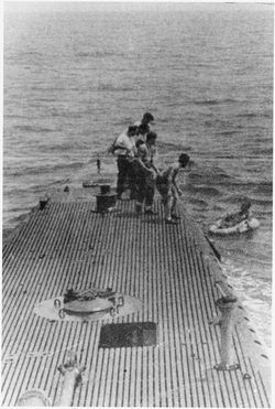 Being rescued by the submarine USS  Finback