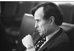 Bush, as CIA Director, listens at a meeting following the assassinations in Beirut of  Francis E. Meloy, Jr.  and  Robert O. Waring  , 1976.