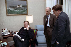 Bush speaks on the telephone regarding Operation Just Cause with General  Brent Scowcroft  and Chief of Staff  John H. Sununu  , 1989
