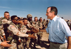 President Bush visited American troops in Saudi Arabia on  Thanksgiving Day  , 1990