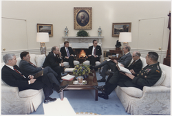 Bush meets with  Robert Gates  , General  Colin Powell  , Secretary  Dick Cheney  and others about the situation in the Persian Gulf and Operation  Desert Shield  , 15 January 1991
