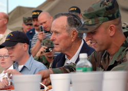 Bush is visiting  NAS JRB  , New Orleans personnel before receiving briefs on the status of  Joint Task Force Katrina  relief efforts, October 2005