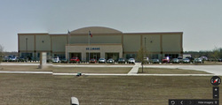 Picture of the Sellmark (parent company of Sightmark) headquarters. The address is2201 Heritage Pkwy, Mansfield, TX 76063