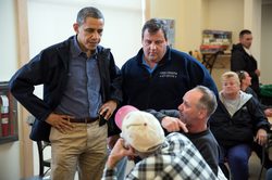 President                                 Barack Obama                                and Governor Chris Christie talk with local residents in                                 Brigantine, New Jersey                                .