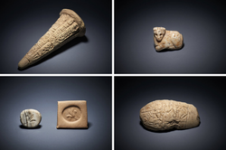 National Museum of Iraq /Clockwise, from top left: A clay cone with a cuneiform inscription; a white marble amulet in the form of an animal; a fragmentary ceremonial weapon made from gypsum; and a white quartz stamp with a seated sphinx. They will be displayed at the National Museum of Iraq in Baghdad.Credit British Museum