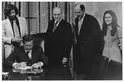 Governor A. Linwood Holton signs H‑210 separating George Mason College from the University of Virginia, April 7, 1972
