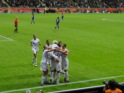 Rapinoe                                 (top)                                celebrates with her teammates after the United States scores a goal during the                                 2011 FIFA Women's World Cup                                final