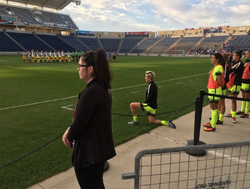Megan Rapinoe kneels during the United States National anthem in September 2016