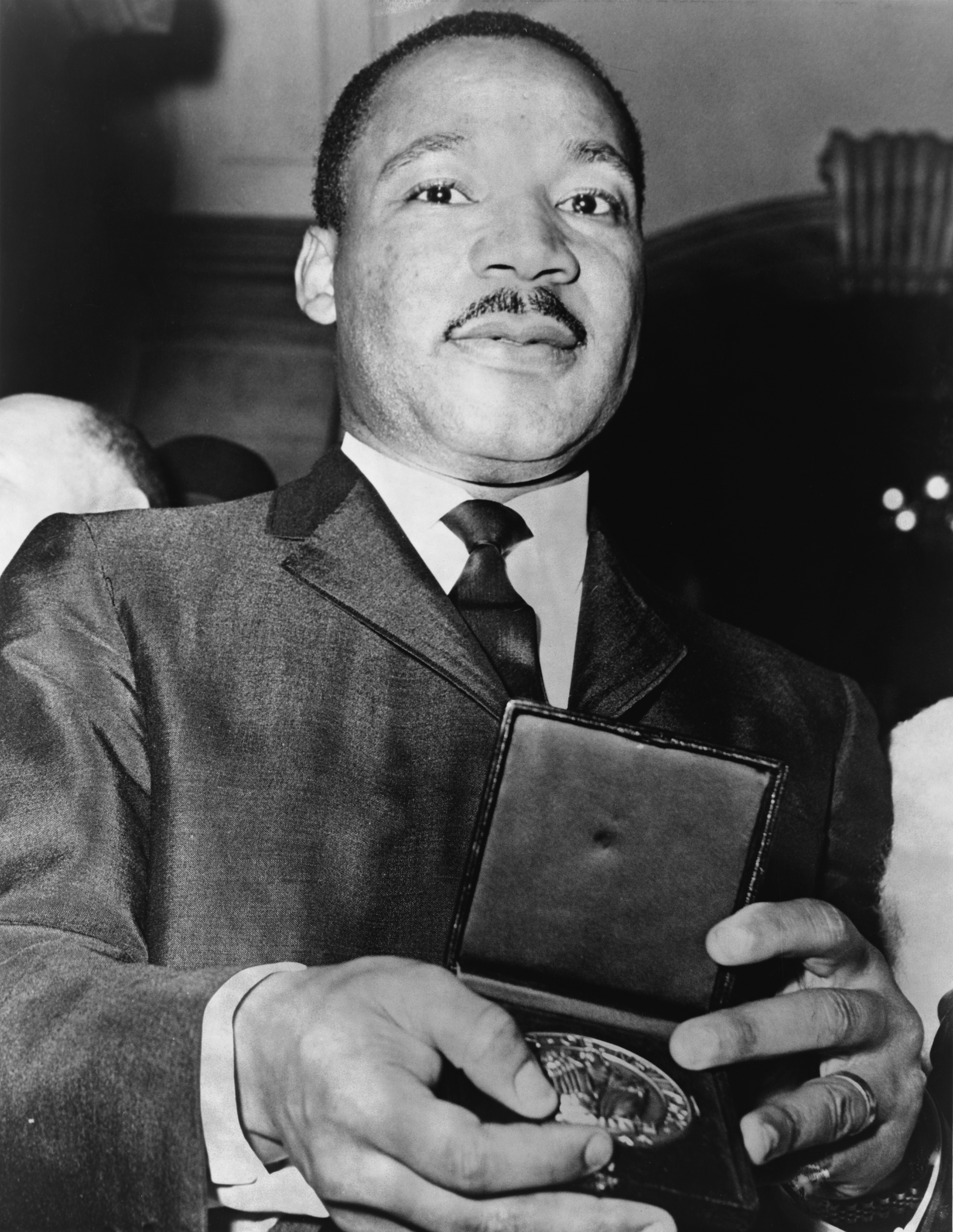 Martin Luther King Jr., showing his medallion received from Mayor Wagner