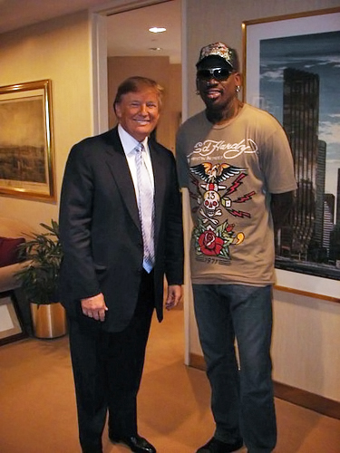 Trump posing with guest basketball personality Dennis Rodman, during Rodman's 2009 participation on Celebrity Apprentice