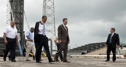 Musk and President                                 Barack Obama                                at the Falcon 9 launch site in 2010
