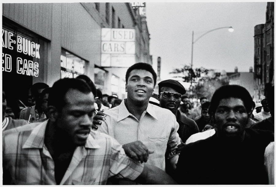 Muhammad Ali walks through the streets with members of the Black Panther Partysoon after he was allowed to fight again. (New York. September 1970)