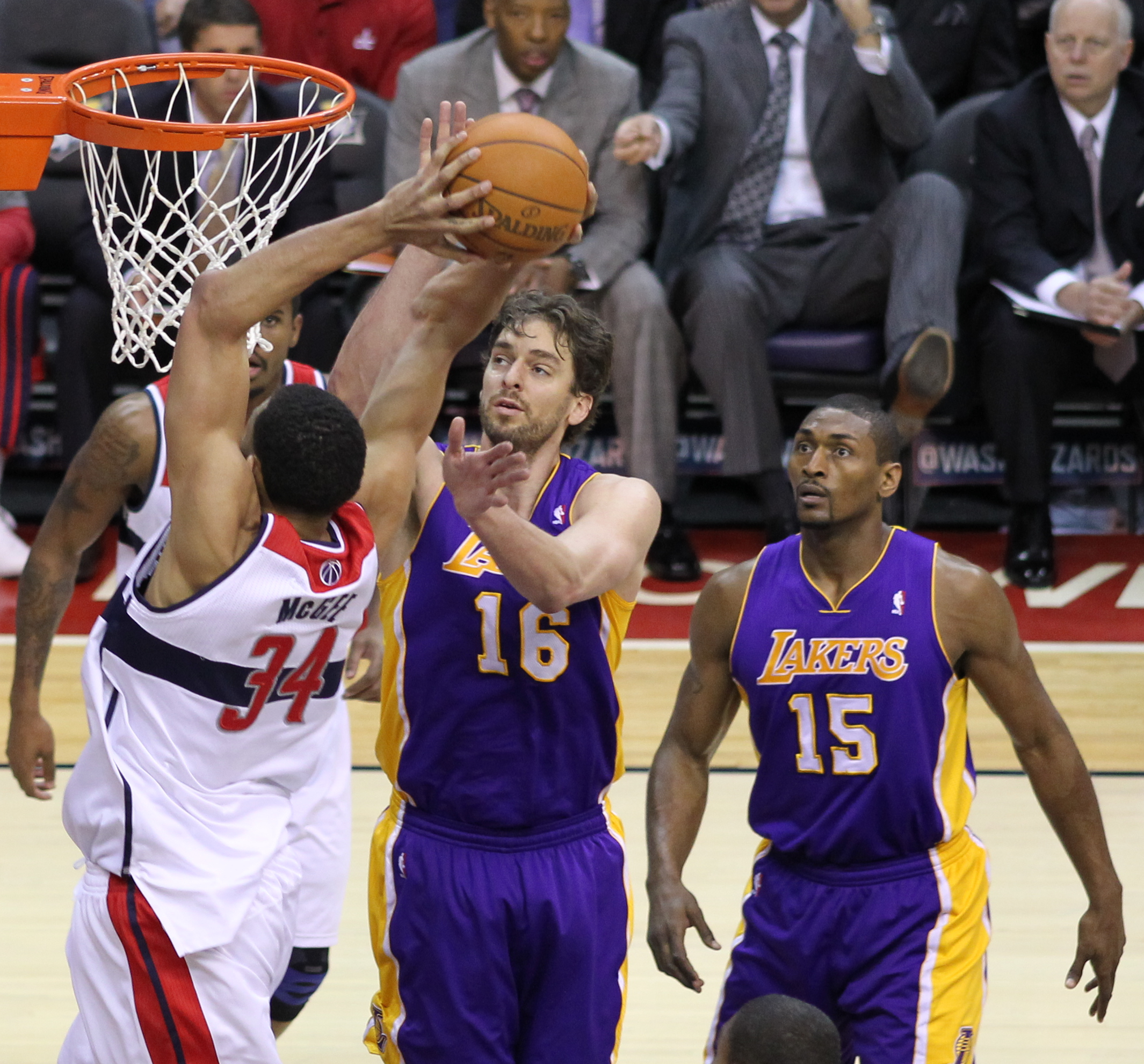 World Peace and Laker Pau Gasol against Washington's JaVale McGee in 2012.
