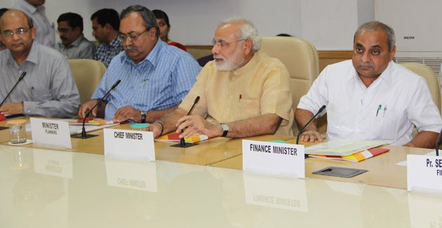 Chief Minister Modi and his cabinet ministers at a Planning Commission meeting in New Delhi, 2013.