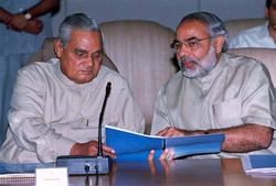 Modi with Prime Minister Atal Bihari Vajpayee in 2002.