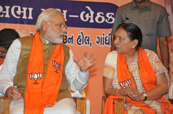 Modi with Anandiben Patel at a meeting of BJP MLAs after his election as prime minister; Patel succeeded him as Gujarat chief minister.