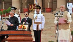 Modi (far right) being sworn in as Prime Minister, in the presence of President Pranab Mukherjee (far left), 2014.