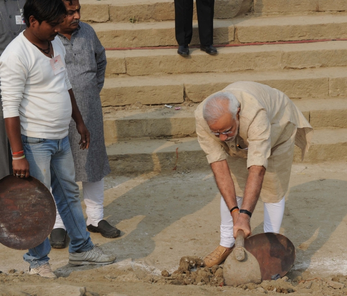 PM Modi participates in cleanliness drive at his constituency in Varanasi.