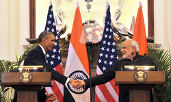 Modi wearing a suit with his name embroidered in the pinstripes.