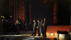 "Carey performing ""One Sweet Day"" alongside Boyz II Men, during a taping at Madison Square Garden in October, 1995."