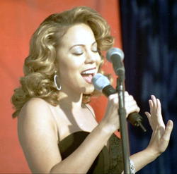 "Carey at the Edwards Air Force Base during the making of the ""I Still Believe"" music video in December, 1998."