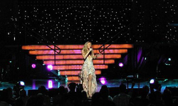 "Carey performing ""Hero"" during her Charmbracelet World Tour, in September, 2003."