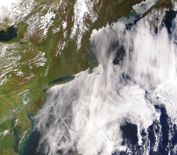 Ship tracks                                can be seen as lines in these clouds over the Atlantic Ocean on the east coast of the United States. Atmospheric particles from these and other sources could have a large effect on climate through the aerosol indirect effect.