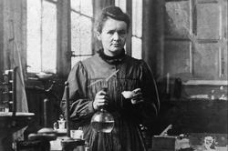 Marie Curie with beakers