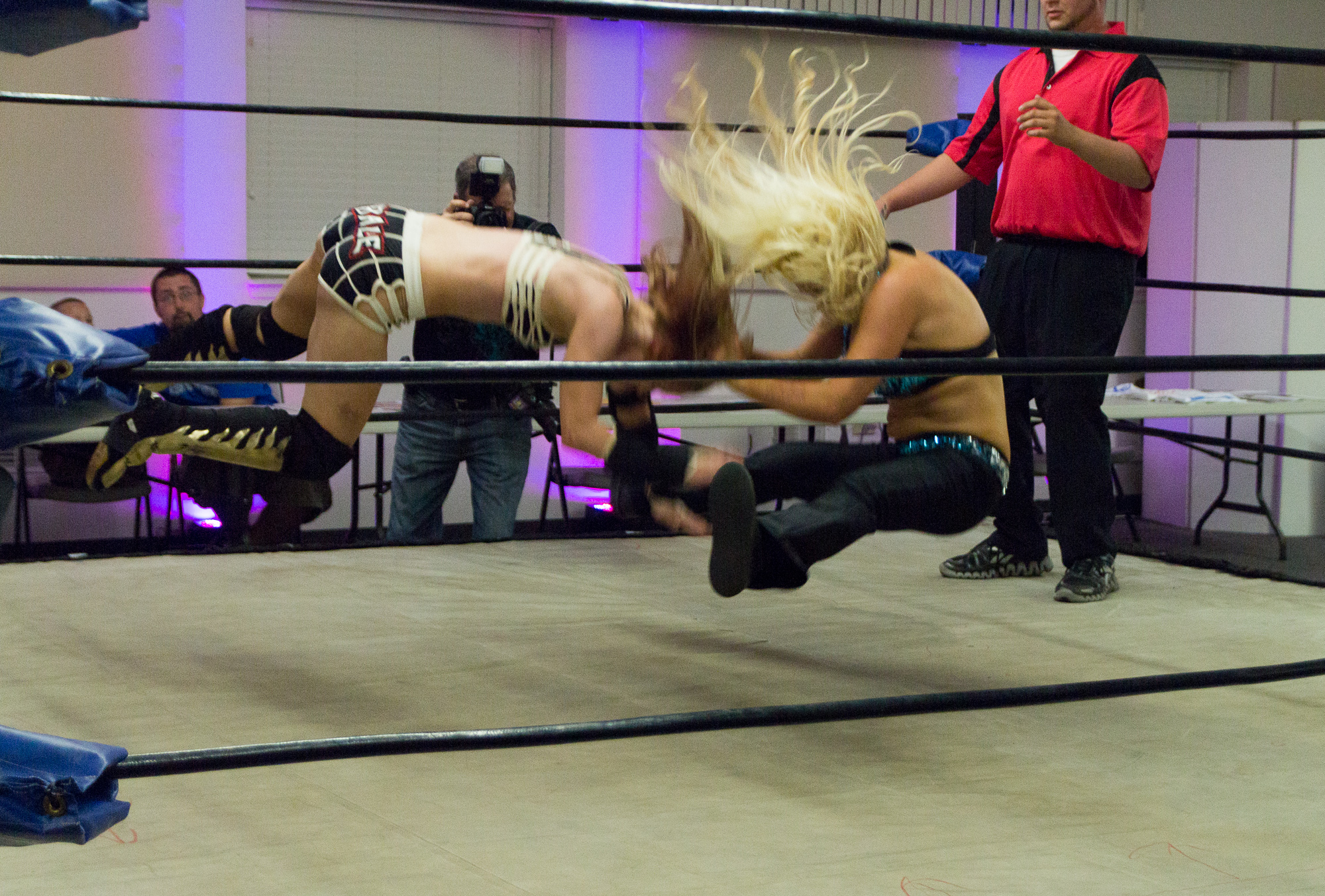 Hall performing a sitout facebuster on Xandra Bale.