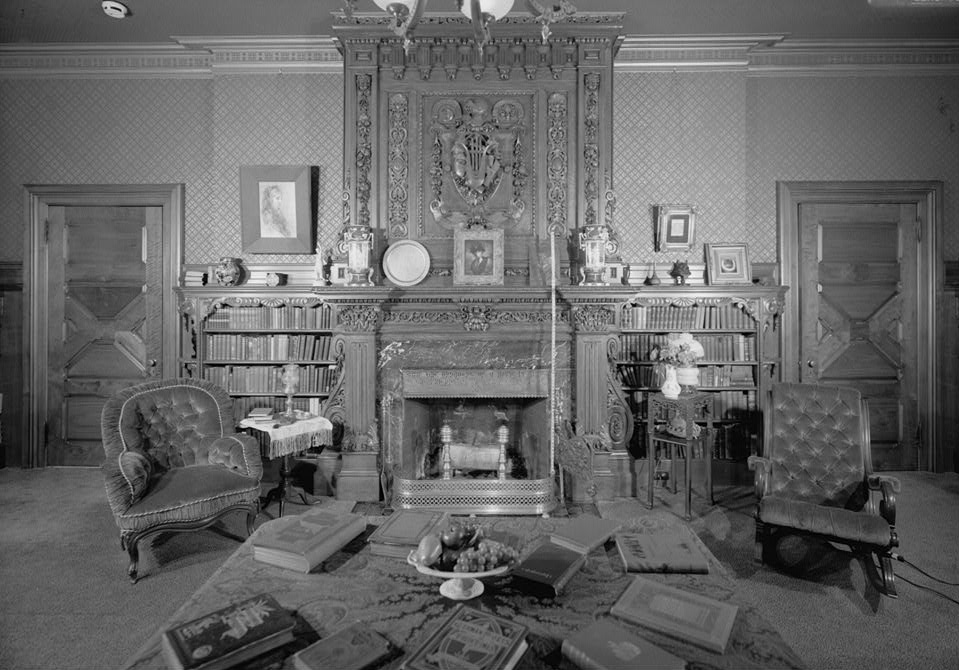 Library of Twain House, with hand-stenciled paneling, fireplaces from India, embossed wallpapers, and hand-carved mantel purchased in Scotland
